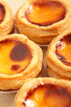 delicious portuguese egg tart with copy space on wooden texture table photo