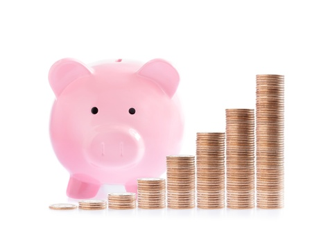 Pink piggy bank and money coins stair isolated over the white background photo