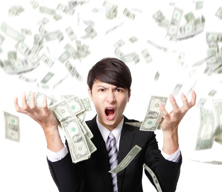 frustrated man: business man anger shouting with money falling rain isolated on white background, asian model