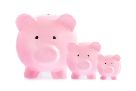 Three pink piggy banks isolated on white background photo