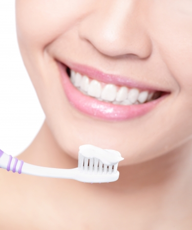 close up of Young smiling woman cleaning teeth with toothbrush, asian beauty model photo