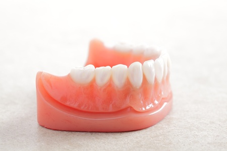 surrogate: Dentures isolated on a white background.