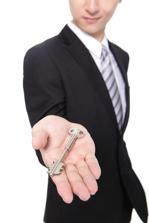 Realtor: businessman holding keys isolated on white background,concept for business or real estate,  asian male Stock Photo