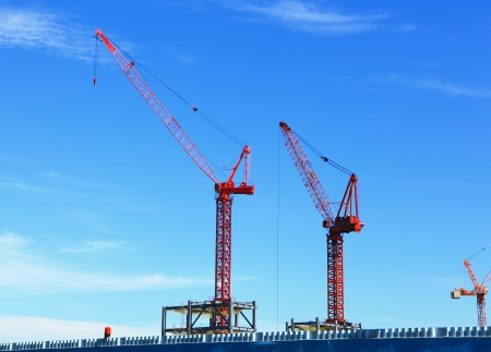 Tower Cranes and construction with blue sky photo