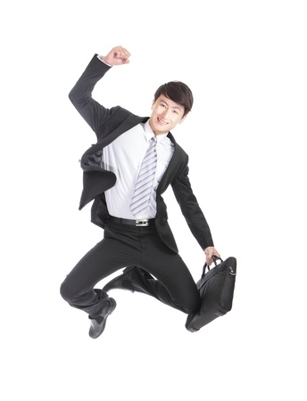 Excited Business man jump  cheerful, asian man photo