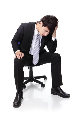 sitting: Frustrated and thinking business man is sitting on chair, full length, isolated on white background