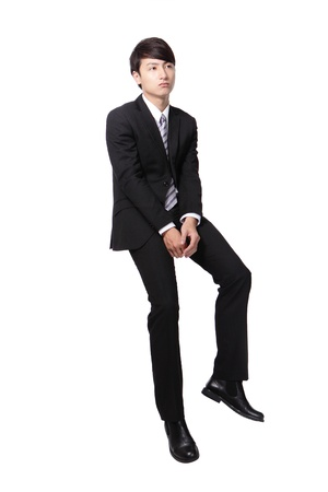 Frustrated business man sitting on something, full length, isolated on white background, asian people photo