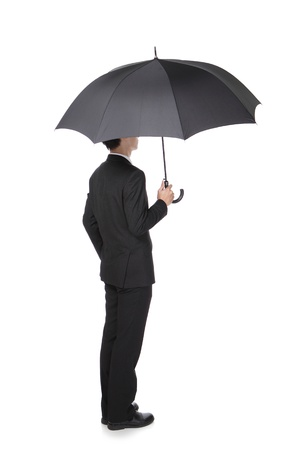 Business Man with an umbrella , concept for business and insurance, isolated against white background, asian male model photo