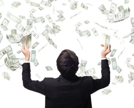 金持ち: ビジネス男抱擁お金白い背景に、アジアのモデルの成功ビジネスのための概念上で分離されての背面図 写真素材