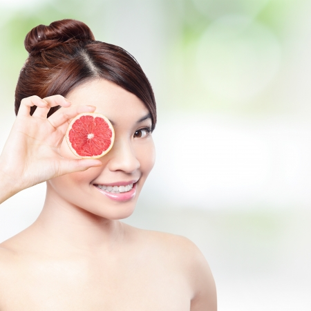 grapefruit for health concept  Woman showing grapefruit and holding grapefruit in front of her eyes  asian beauty model photo