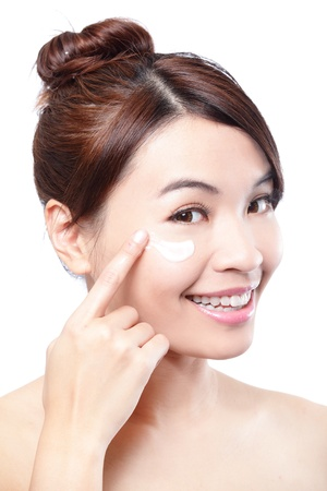 Beauty young woman applying cosmetic cream under eyes, concept for eye and skin care,  asian beauty photo