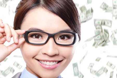 business woman touch eye glasses with money falling rain isolated on white background  Asian woman model photo