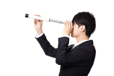Businessman with telescope looking forward Stock Photo - 20481720