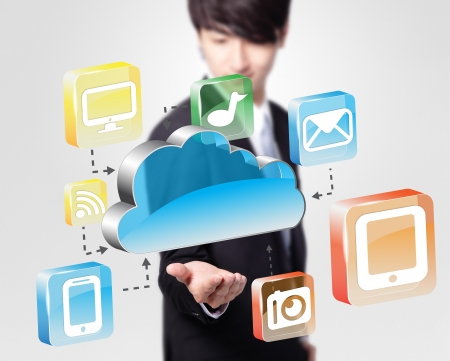 Cloud computing concept - Business man look cloud computing icon in the air Stock Photo - 20598757