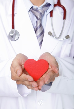 doctor holding a red love heart , Health care concept, asian people photo