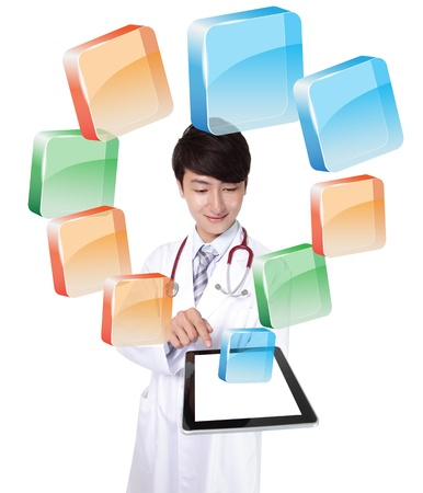 Doctor using digital tablet pc with colorful icon, copy space for your design. Isolated on white background, asian model photo