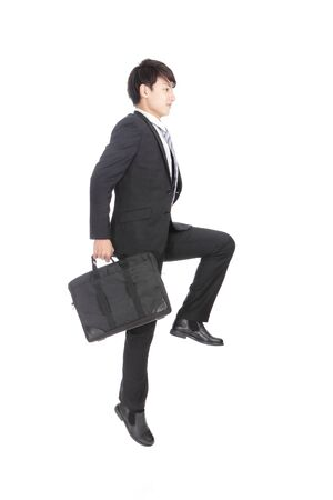 jump suit: Business man jump and hold briefcase cheerful, asian man Stock Photo