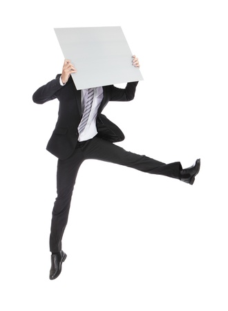 holding blank sign: business man running jumping and holding whiteboard (billboard) isolated on white background in full length, asian male Stock Photo