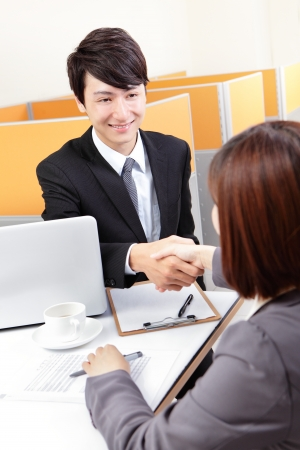 agreements: Portrait of successful businessman at the interview shaking hands at office, asian people