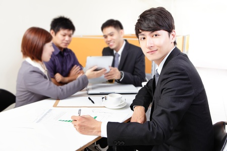 business people group meeting and using touchpad at office, asian people photo