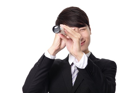 Businessman with telescope ( spyglass ) looking forward Prospects for future business. isolated on white background, asian model Stock Photo - 20696577
