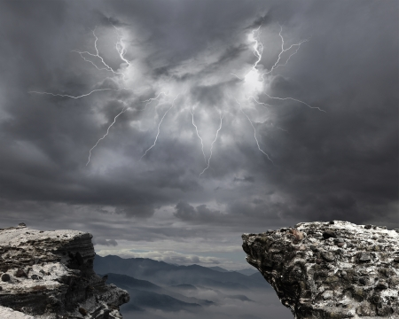 danger precipice on the mountain with rainstorm clouds and lightning Imagens