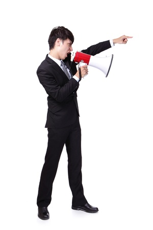 Young business man shouting into a megaphone and finger point to up forward in full length isolated over a white background, asian model photo