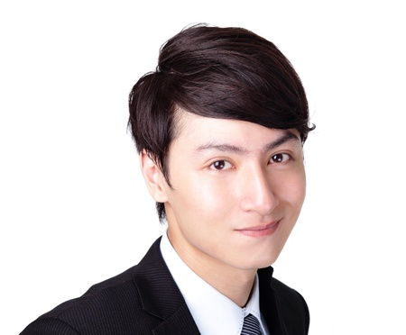 Young handsome business man with great smile isolated on white background with lots of copy space, asian model photo