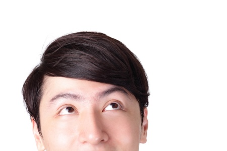 closeup of young man looking up, isolated on white background, asian man