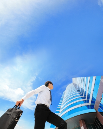 free running: happy successful business man outdoors Next to Office Buildings with cityscape and sky in the background, asian people