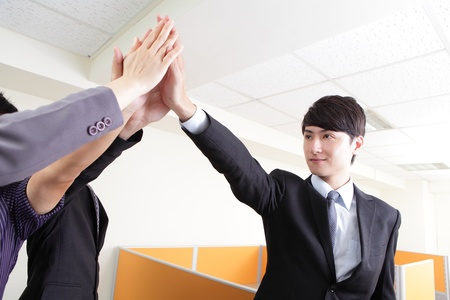 five people: Successful business people group celebrating with hands giving high five at office, asian people