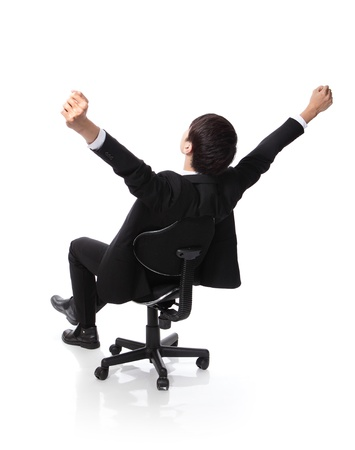 back to work: Back view of Successful excited Business man sitting in chair, young businesspeople smile raised hands arms, Isolated over white background, asian people