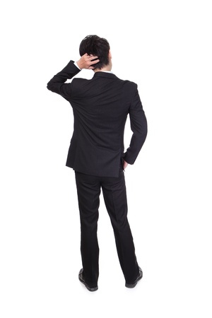 Back pose of a business person thinking. Isolated over white background, full body, asian model photo