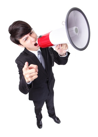 Business man screaming loudly in a megaphone isolated on white background,  high angle view, model is a asian male photo