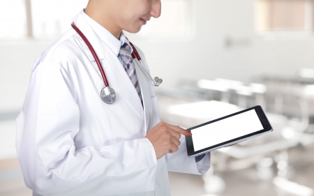 man doctor: Doctor showing blank tablet pc in hospital, asian model