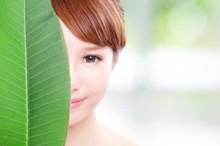 asia nude: beautiful woman face portrait with green leaf , concept for skin care or organic cosmetics , asian beauty model Stock Photo
