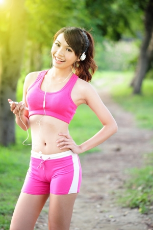 asian trees: Running woman in park  Asian sport fitness model in sporty running clothes  Stock Photo