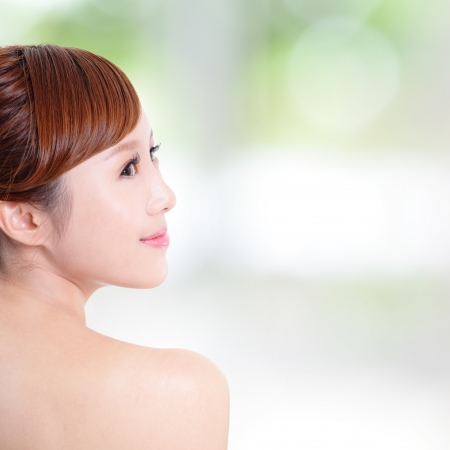woman face profile: portrait of the woman with beauty face and perfect skin isolated on green background, asian model