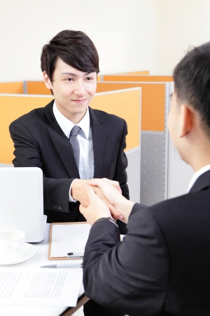 Portrait of successful businessman at the interview at office, asian people photo