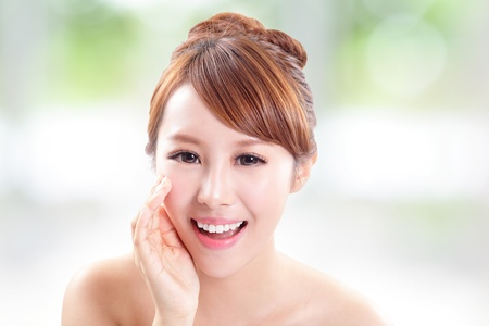 chinese woman: attractive woman with health skin and teeth, she is happy talk to you with nature green background, asian model