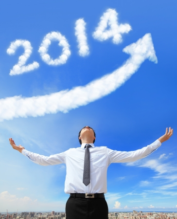 happy new year 2014, Business man hug 2014 (white cloud and blue sky on sunny day) photo