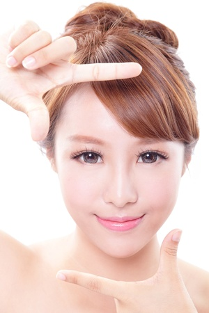 Beautiful Woman face and she making frame with hands, concept for skin care , asian woman
