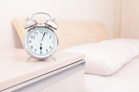 alarm clock and bed in the morning Stock Photo - 21737092