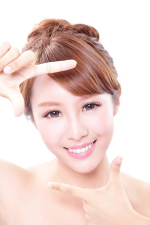 Beautiful Woman face and she making frame with hands with health skin and teeth, concept for skin care and dental care, asian woman photo