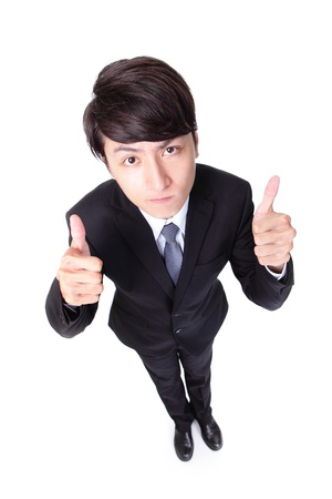 young handsome business man show thumb up in full length isolated on white background, high angle view, asian model photo
