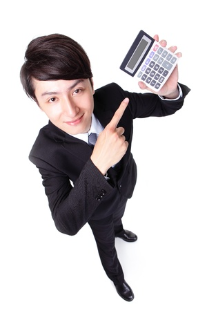Attractive business man pointing a calculator isolated on white background, high angle view, asian model
