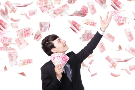 rmb: happy business man hold China money ( Renminbi ) under a money rain - isolated over a white background, asian model