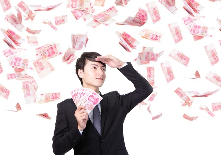 yuan: happy business man hold China money ( Renminbi ) under a money rain - isolated over a white background, asian model