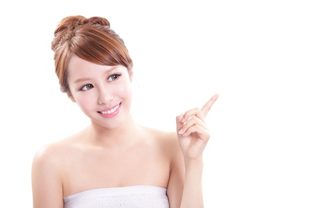 beautiful girl face: Beauty portrait of young woman showing beauty product  empty copy space with finger pointing, asian beauty