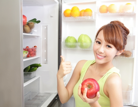 refrigerator with food: Healthy Eating Concept .Diet. Beautiful Young Woman near the Refrigerator with healthy food. Fruits and Vegetables, asian model
